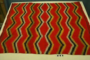 a hand woven multi-colored wool rug